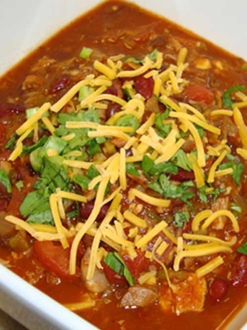 Sock Rockin' Chicken Chili Recipe - This Sock Rockin' Chicken Chili is a light textured chili with a very fresh taste and just enough spicy kick to knock your socks off!